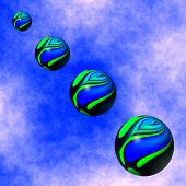 stock photo of descending  - Graphic illustration of colorful spheres descending from the blue sky - JPG