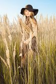 image of tallgrass  - Sunrise shot of a model in tallgrass meadow - JPG