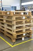 stock photo of assembly line  - Wooden pallets are made up at a designated place in the assembly hall - JPG