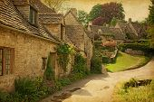 image of hamlet  - Traditional Cotswold cottages after the rain - JPG