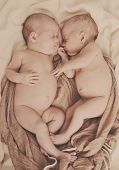 picture of identical twin girls  - twins are sleeping and hugging in soft focus - JPG
