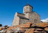 foto of trinity  - 14th century Holy Trinity Church (Tsminda Sameba) near Mount Kazbek in Georgia ** Note: Shallow depth of field - JPG