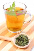 image of nettle  - Fresh and dried nettle with cup of hot beverage concept for healthy eating - JPG