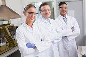 image of scientist  - Smiling scientists looking at camera arms crossed in laboratory - JPG