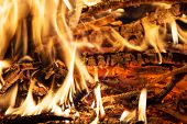 stock photo of firewood  - The burning firewood in the fireplace closeup  - JPG