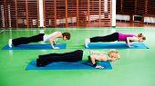 image of yoga instructor  - Girls practicing yoga - JPG