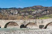 stock photo of apennines  - Stone bridge over the river Trebbia near Bobbio - JPG
