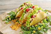 image of tacos  - Tasty taco with greens on paper close up - JPG