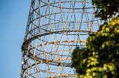 foto of fragmentation  - Fragment of the Shukhov radio tower also known as the Shabolovka tower with tree on the foreground - JPG