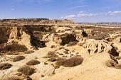 foto of arid  - Arid landscape at daytime in Bardenas Reales Navarra Spain - JPG