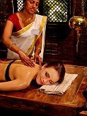 stock photo of panchakarma  - Young woman having oil spa Indian treatment - JPG