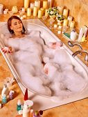 stock photo of bubble bath  - Woman relaxing at water in bubble bath - JPG