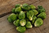 foto of brussels sprouts  - few Brussels sprouts on old wooden table - JPG