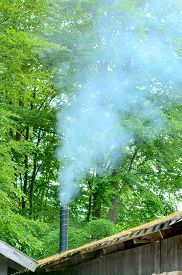 foto of canopy roof  - Thick smoke comes out of steel pipe chimney - JPG