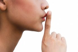 stock photo of hush  - A woman touching her lips to hush - JPG