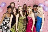 stock photo of 16 year old  - Group Of Teenage Friends Dressed For Prom - JPG