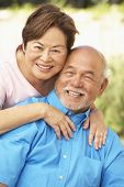 stock photo of senior adult  - Senior Couple Relaxing In Garden Together - JPG