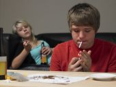 image of teen smoking  - Teenage Couple Taking Drugs At Home - JPG