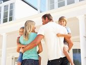stock photo of dream home  - Young Family Standing Outside Dream Home - JPG