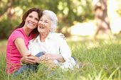 stock photo of mature adult  - Senior Woman With Adult Daughter In Park - JPG
