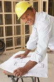 image of close-up  - Architect Studying Plans In New Home - JPG