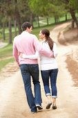 stock photo of walking away  - Romantic couple enjoying walk in park - JPG