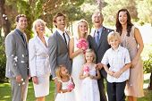 stock photo of ten years old  - Family Group At Wedding - JPG