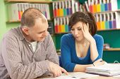 picture of tutor  - Teenage Student In Classroom With Tutor - JPG
