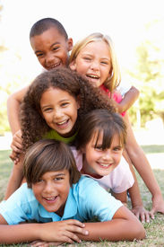 pic of children group  - Group Of Children Piled Up In Park - JPG