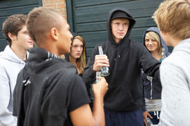 image of underage  - Group Of Threatening Teenagers Hanging Out Together Outside Drinking - JPG