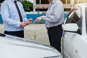 Traffic Accident And Insurance Concept, Insurance Agent Working On Report Form With Car Accident Cla poster