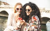 Happy Multiracial Girlfriends Having Fun Outddors With Mobile Smart Phone - Friendship Concept With  poster