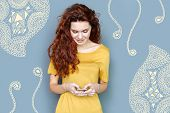 Typing Messages. Cheerful Young Calm Woman Standing With A Smartphone In Her Hands And Typing Messag poster
