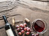 Wine glass, wine bottle and grapes on wooden background. Wine tasting. poster