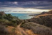 Dramatic Clouds And Coastline View Of The Pacific Ocean From The Corral Canyon Trail In Malibu, Cali poster