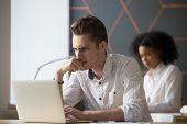 Puzzled Serious Male Office Employee Solving Online Problem Stressed About Difficult Task Worried By poster