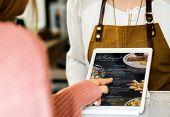 Customer ordering food at restaurant counter poster