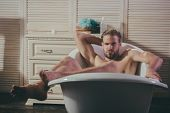 Macho Relax Naked In Bathtub In Bathroom. Macho With Muscular Legs, Chest, Arms, Biceps, Triceps In  poster