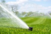 Irrigation System Sprinkles Water Fountain For Long Distance Irrigated Golf Course poster