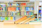 Old Book Red - Green. And Heap Treatise In School Library On Wooden Table.  Blurry Bookshelves Backg poster
