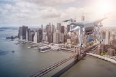 unmanned Multicopter drone flying over lower Manhatten, New York City poster