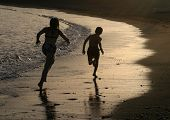 picture of mear  - Two kids running down a beach mear Malaga in Spain - JPG