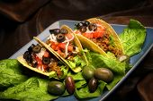 pic of mexican food  - mexican tacos on blue plate with lettuce - JPG