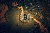 Golden Bitcoin Cryptocurrency On Computer Electronic Circuit Board., Bitcoin And Microchip Concept. poster