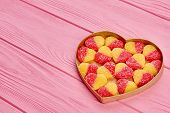 Tasty Candies In Heart Shaped Box. Colorful Heart Shaped Marmalade Candies In Heart Shaped Container poster