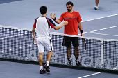 BUKIT JALIL, MALAYSIA- OCT 01::Serbia's Janko Tipsarevic (red) shakes the hands of Japan's Kei Nishi