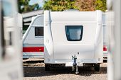 Rv Travel Trailer Storage Parking. Modern Recreational Trailer With Front Window. Camping And Travel poster
