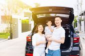 Happy Asian Family Standing On The Back Of Suv Car With Smile And Happiness poster