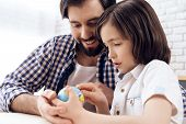 Adult Father Helps Son Learn Geography Using Globe. Studies Of Geography. Self Education Concept. poster