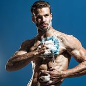 Spa And Beauty, Relax And Hygiene, Healthcare - Handsome Man Washing With Sponge In Shower. Athletic poster